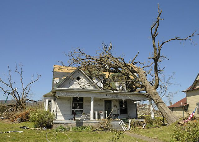 Damaged home in Arkansas (Find the Best Home Contents Insurance)