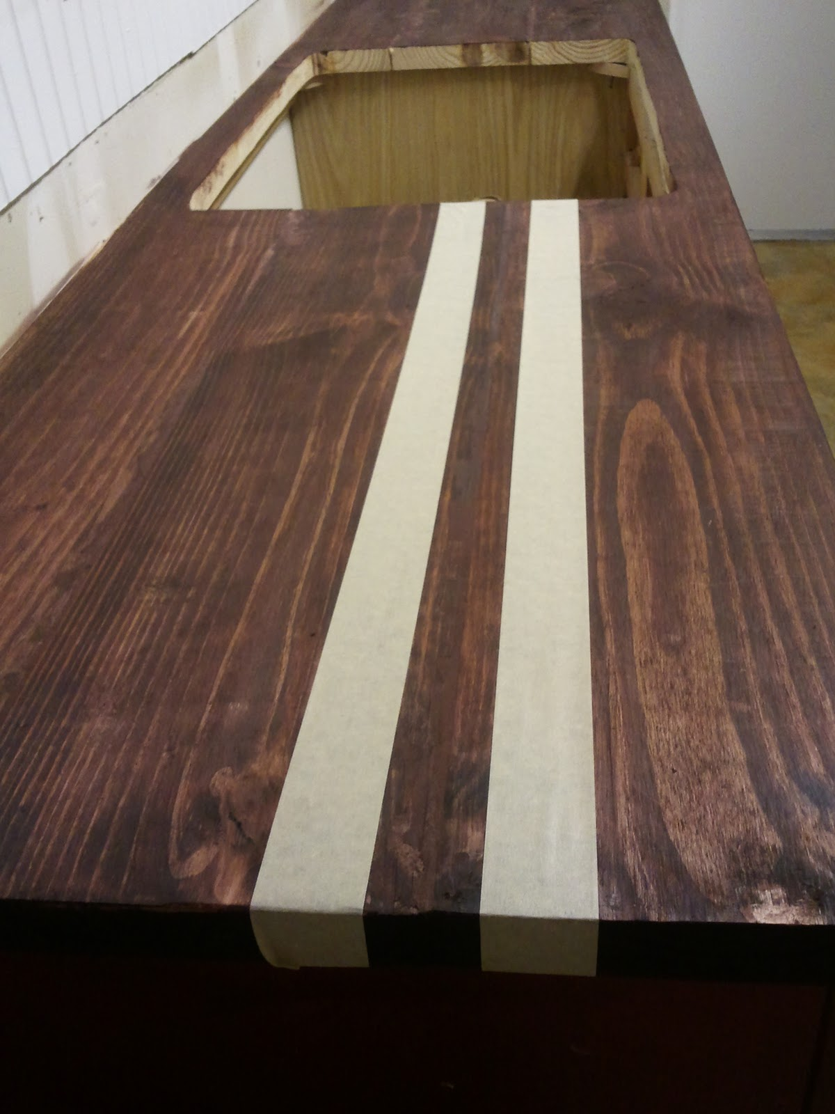 Use Tape to Tape of Sections on the Wood - DIY Faux Butcher Block Countertops Tutorial