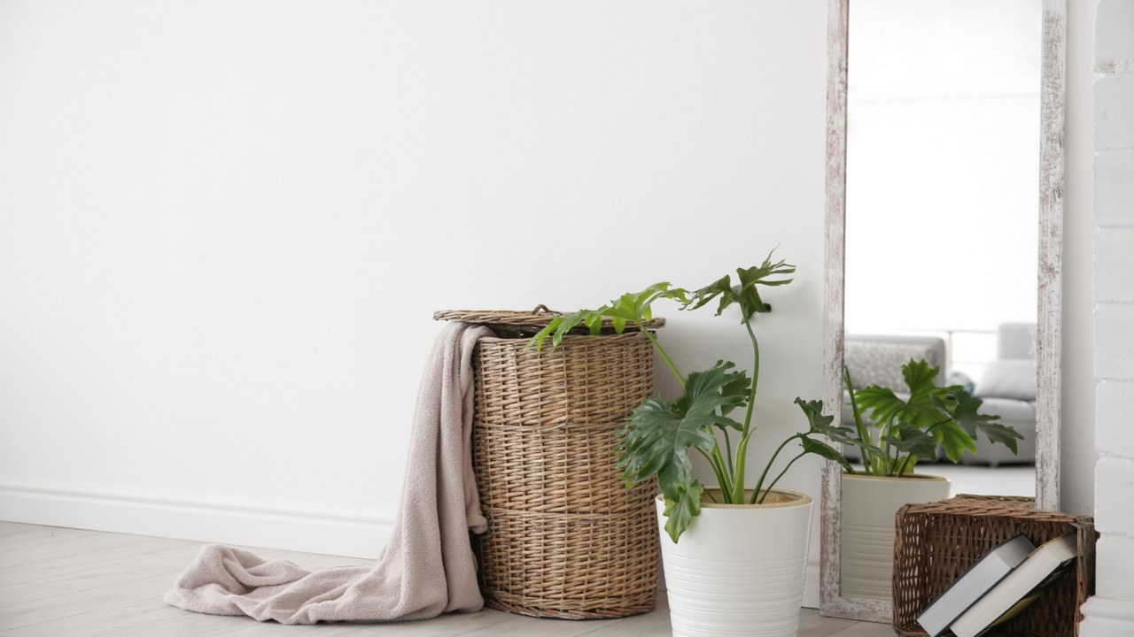 image - A tall mirror and a couple of baskets give an aesthetic look for your room rental in Chicago.